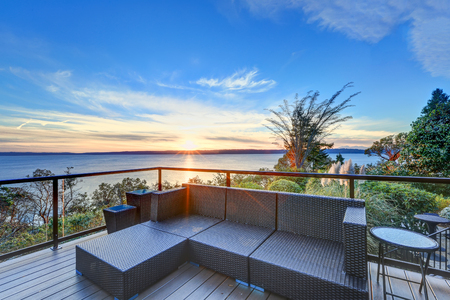 puget: Modern two story panorama house boasts large deck furnished with wicker seats. Awesome sunset view of Puget Sound. Northwest, USA