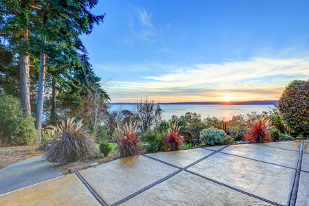 puget: Exterior of panorama house with gorgeous view of Puget Sound, view from the patio area with stone floor. Northwest, USA