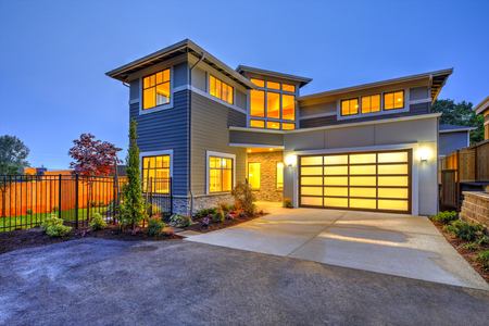 Beautiful curb appeal of a Modern craftsman style home, sunset time. Northwest, USA