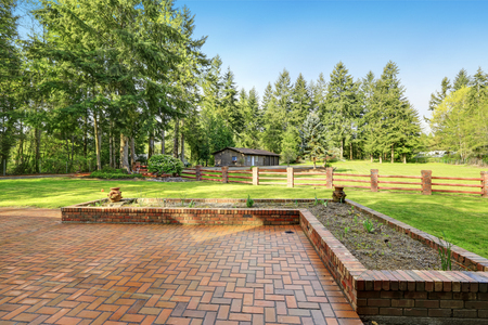 Exterior of Beautiful Secluded home with Large brick paved Patio for Entertaining, a view of Guest Suite and detached Car Garage spaces. Northwest, USA