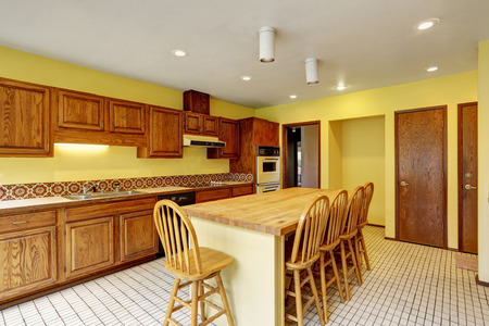 Open Kitchen with Large Island leads to Family Room and Formal Dining Room. Northwest, USA
