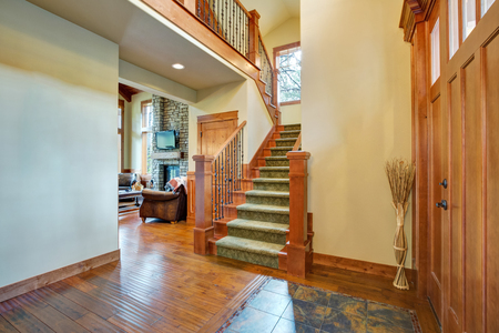 Welcoming Entrance Hallway Boasts Hardwood Floor Mixed With Tile