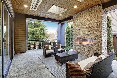 Beautiful back yard interior with stone fireplace