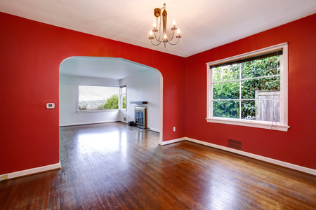 Transitional dining room with red walls in a craftsman style home.