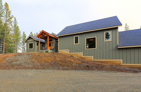 Exterior of a new gray wooden country house in Cle Elum, WA.