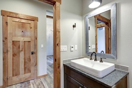 White and fresh bathroom interior with a rectangular vessel sink and dark gray countertop. Zdjęcie Seryjne - 114014737
