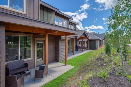 Beautiful new homes with back yard small porches in brown natural tones Standard-Bild