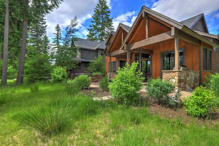 Beautiful large American Northwest home  exterior with brown wood in the forest