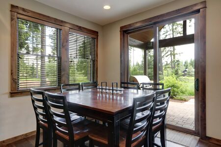 Dining room with dark wood square table and large sliding door