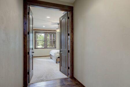 Empty grey hallway walls near the bedroom with french doors. Stock fotó