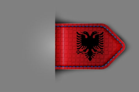 Flag of Albania in the form of a glossy textured label or bookmark. Vector illustration. Vector