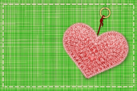 Fuffy pink heart on the green colored textile texture. Vector illustration.