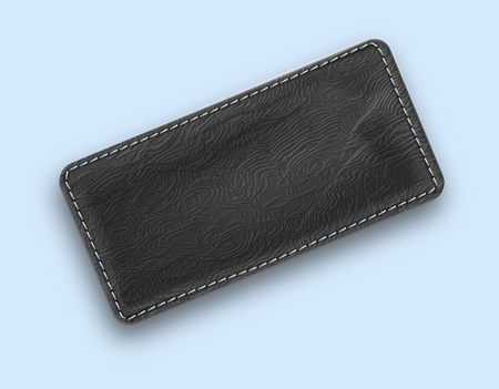 Leather black realistic stitched rectangle. Textured tag with shadow. Vector illustration