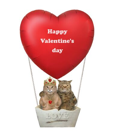 The two cats in love are flying in a red heart shaped hot air balloon. Happy Valentines day. White background. Isolated. 版權商用圖片