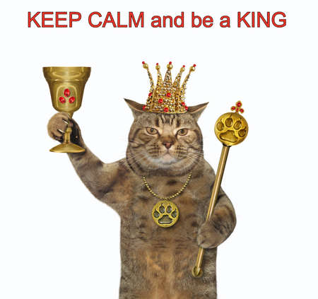 The beige cat in a crown with a gold paw print pendant is holding a goblet with rubies and a royal scepter. Keep calm and be a king. White background. Isolated.