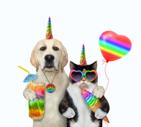 A dog unicorn with a glass of juice hugs a cat unicorn with a cone of ice cream. White background. Isolated. Reklamní fotografie