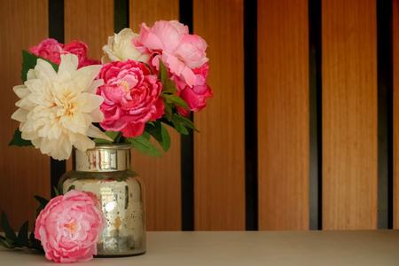 Beautiful bouquet with artificial silk flowers peonies in the beautiful bouquet with artificial silk flowers peonies in the can wooden background stock photo mightylinksfo