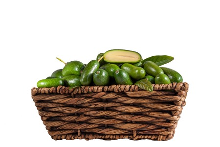 Fresh seedless cocktail avocado in the basket isolated on white background. Cucumber avocado. Marks and Spencer new genetic gift for avocado fans Stock Photo