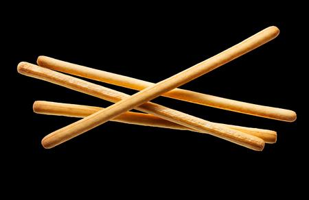 breadsticks isolated on black