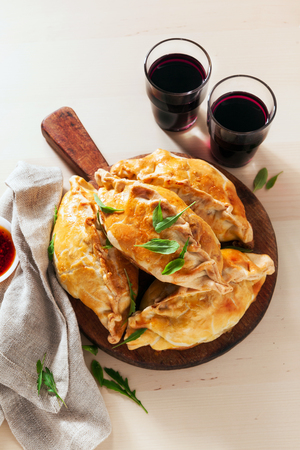 Leek, cheese & potato Homemade Pasties with red wine and spicy sauce