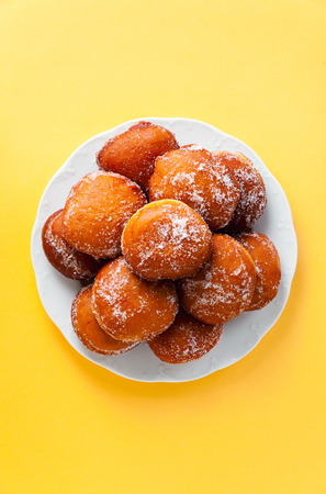 round jelly doughnut sufganiyah for Hanukkah, Jewish holiday commemorating the rededication of the Holy Temple  Stock Photo