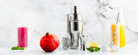preparation of a drink, a cocktail on a marble table. all the necessary tools, utensils and ingredients. copy space, banner Stock Photo
