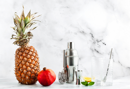 preparation of a drink, a cocktail on a marble table. all the necessary tools, utensils and ingredients. copy space Stock Photo