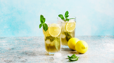 iced green tea with lemon and fresh mint .Copy space Stock Photo