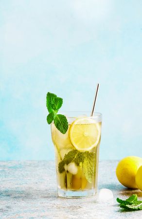 Traditional iced tea with lemon and ice in tall glasses