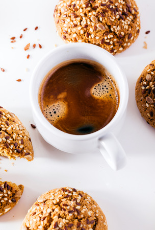 a cup of espresso and fresh biscuits on a white background. a frame for bars, cafes, coffee houses, bakeries  and restaurants with fresh pastries