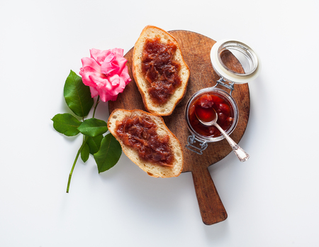 freshly made homemade jam from roses. summer conservation. isolated on white