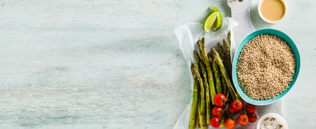 banner of grain Sorghum or great milet with green asparagus and cherry tomatoes on the table. ingredients for gluten-free recipes. healthy cuisine for people with celiac disease 版權商用圖片