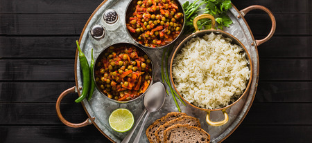 banner of vegan curry with green peas and basmati rice served on a wooden table tray, healthy Indian comfort food