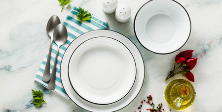 banner of set of white empty enamel bowls on the table. table setting Reklamní fotografie