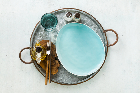 empty plates on the table set for lunch or dinner. Stock Photo