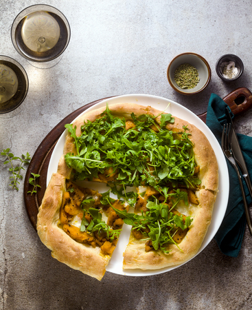 traditional Italian white pizza with taleggio cheese, caramelized pumpkin and arugula on the table Stok Fotoğraf