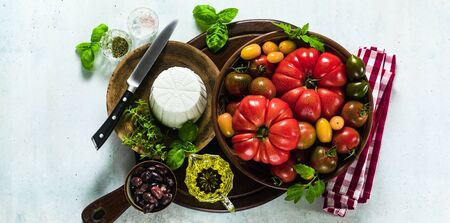 banner of ingredients for the preparation of summer salad of colorful tomatoes, olives and ricotta. Mediterranean recipes