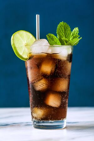 Coca Coke cocktail in a tall glass cuba libre. refreshing summer drink