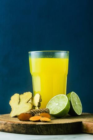 golden ginger and turmeric drink with lime juice. Healthy anti-inflammatory drink of natural medicine and naturopathy