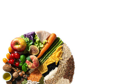 circle of basic vegan ingredients and products. cereals, legumes, fresh vegetables and fruits, oils, seeds and nuts. balanced healthy diet isolated on white