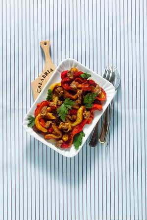 Calabrian summer baked peppers appetizer with sun-dried tomato and nut sauce. Vegan Health Food