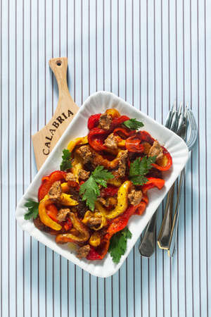 Calabrian summer baked peppers appetizer with sun-dried tomato and nut sauce. Vegan Health Food Reklamní fotografie - 150876395