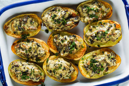 vegan baked potatoes with mushrooms in bechamel sauce with soy milk. healthy lunch or dinner for the family 写真素材