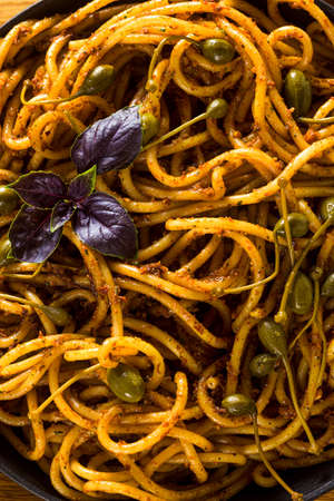 Bucatini pasta with Sicilian almond pesto. traditional vegan italian cuisine 版權商用圖片