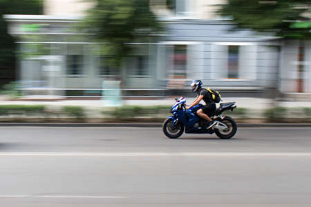 motorbiker on the city street in motion blur Archivio Fotografico