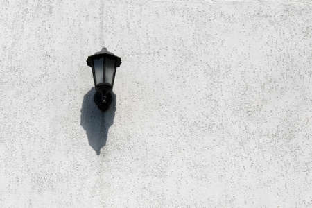 street lamp lighting on white painted wall