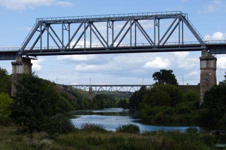 landscape of bridge in frame of bridge across the river Stock fotó
