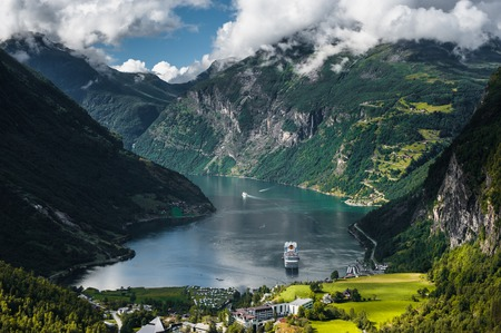 View on Cruise ship in Geiranger fjord from Dalsnibba mountain, Norway photo
