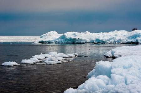 Day at Baikal Lake. Spring floating of ice . photo