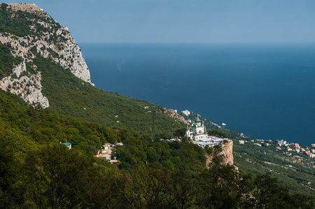 Top view Church of Holy Resurrection of Christ on Red cliff and township Foros on Black sea coast, Crimea, Russia